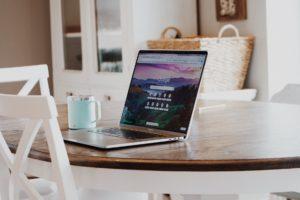 macbook on brown wooden table